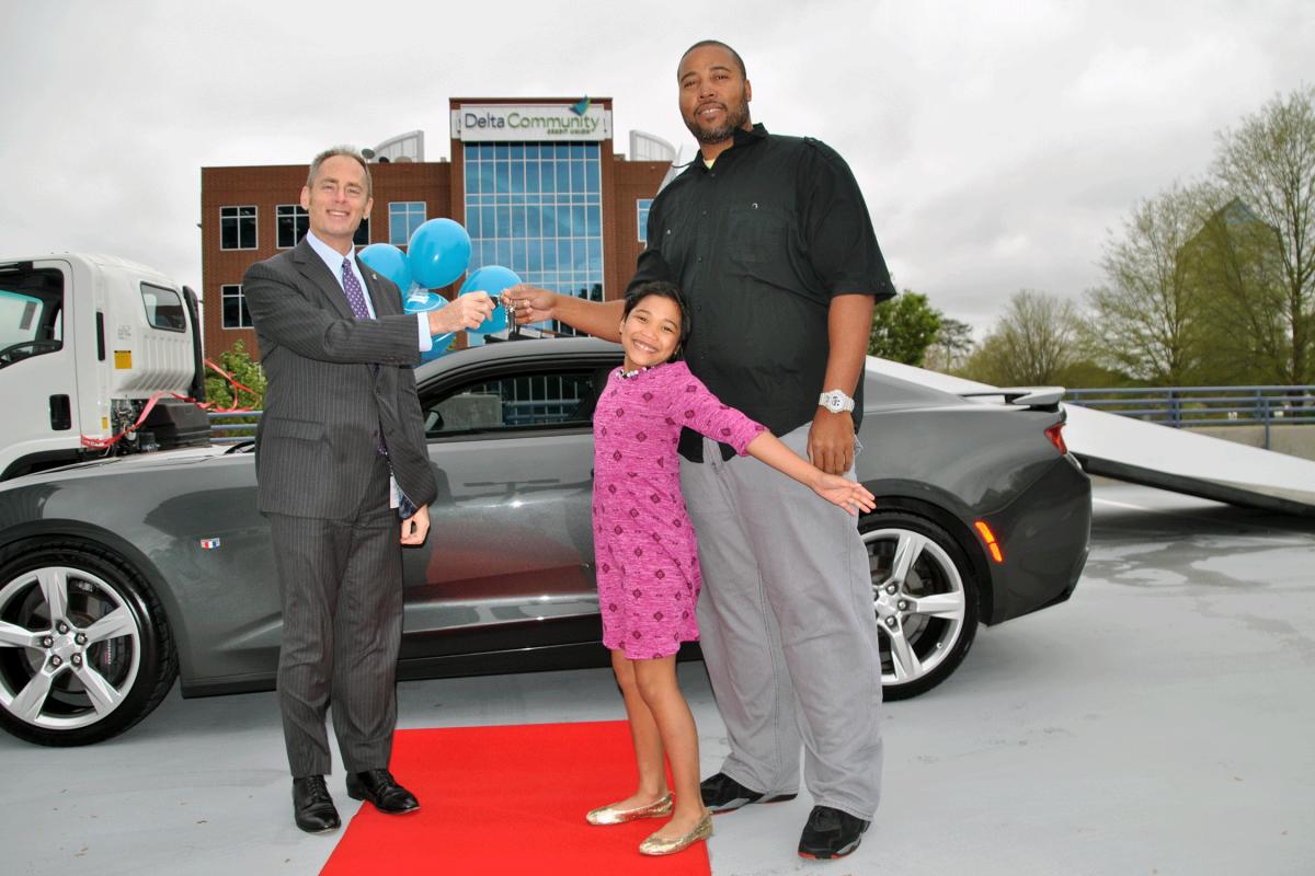 Delta Community and Carvana award car to family seeking mini van