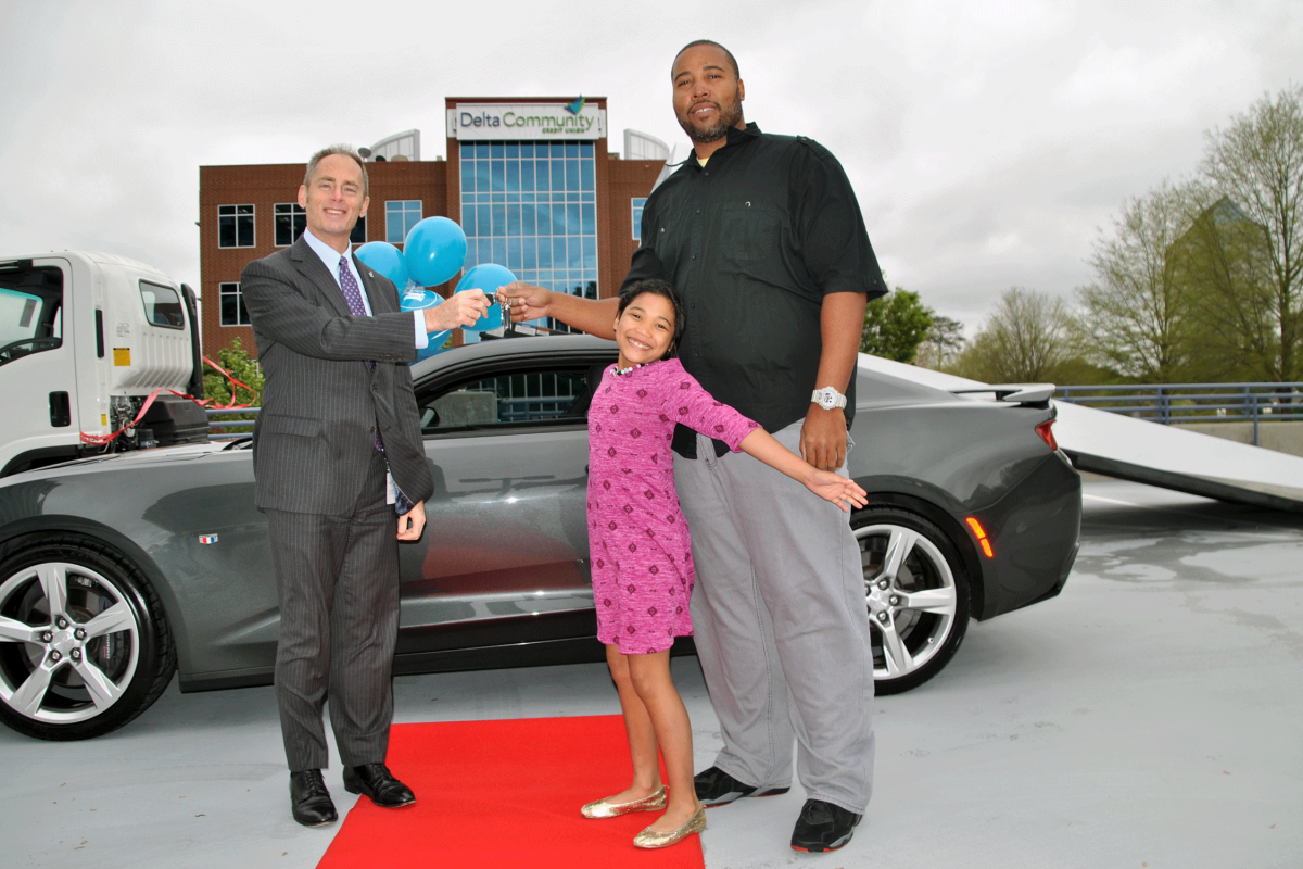 Delta Community and Carvana award car to family seeking mini van