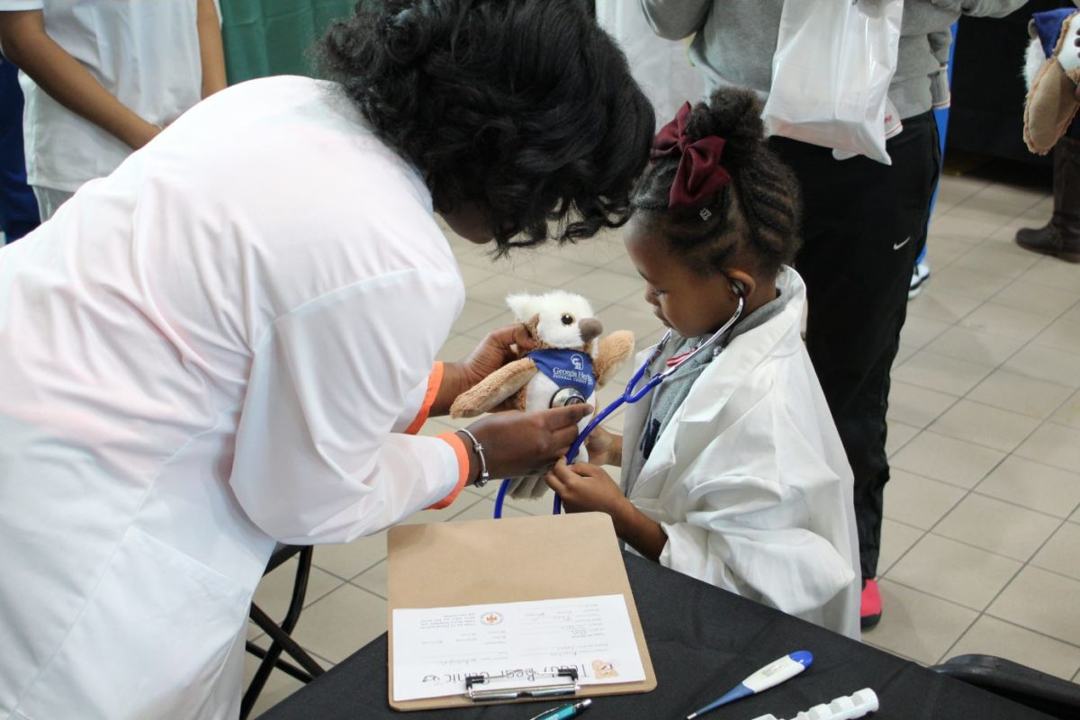Georgia Heritage Federal Credit Union donates more than 50 stuffed animals to local Teddy Bear Clinic