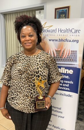 Khalilah Chisholm Receives the Employee of the Year Award from Broward HealthCare Federal Credit Union